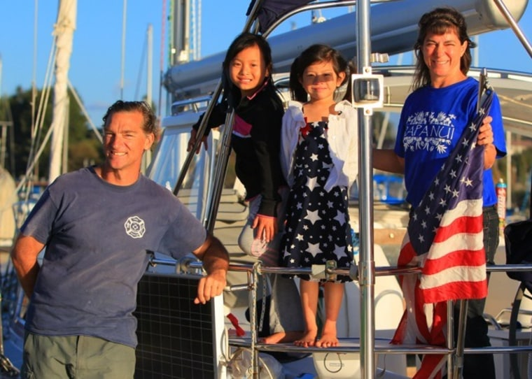 The Maddox family on their boat in Canada in 2010. From left: Glenn, Linzi, MeiLing and Pam.