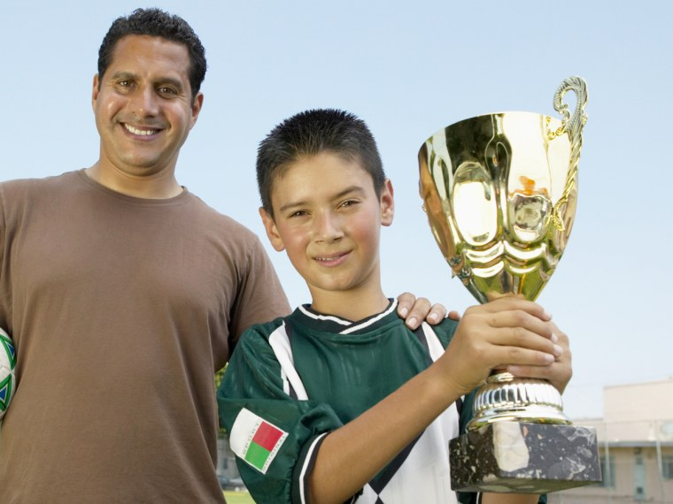 Did he win the championship, or ride the bench? Some parents think we're overdosing on trophies.