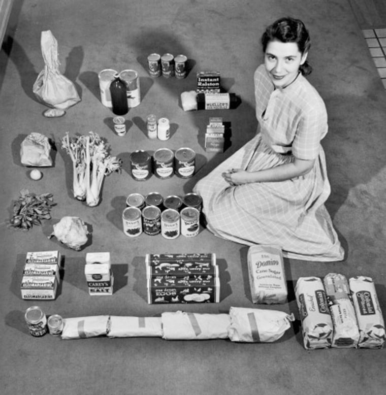 Ann Cox Williams poses with a week's worth of groceries in 1947.