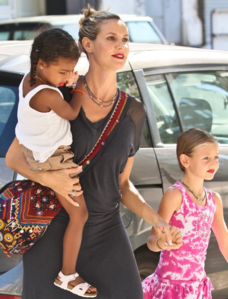 No boys allowed: Supermodel Heidi Klum took her two young daughters Lou (left) and Leni (right) to the Children's Museum of Arts in New York on July 24.