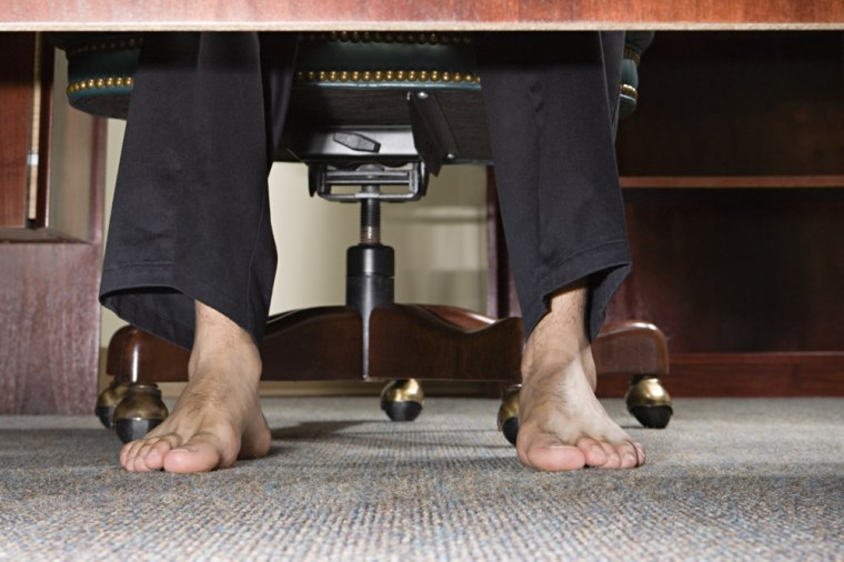 Want to get ahead at work? Put your shoes on, and save your nail clipping for after hours.