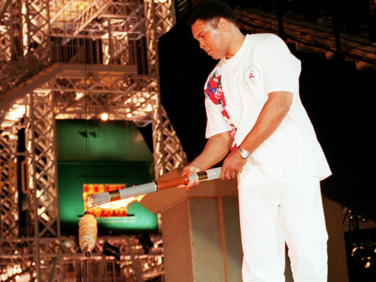 Muhammed Ali lights the Olympic cauldron in 1996.