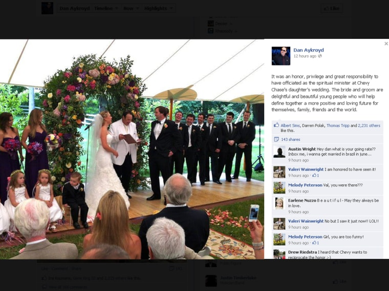 Dan Aykroyd officiates at Chevy Chase's daughter's wedding.