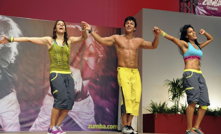 Alberto Perez, center, founder of Zumba Fitness, performs on stage during a meeting in Rimini, central Italy on May 11. Doctors around the country say they're seeing an uptick in Zumba-related injuries, no doubt because more people are trying the hugely popular fitness classes.