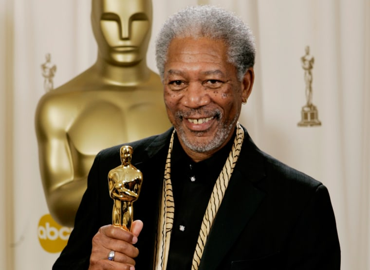 """Morgan Freeman poses with the Oscar he won for best supporting actor for his work in """"Million Dollar Baby"""" on Feb. 27, 2005."""