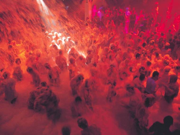 It's all fun and games until someone gets hurt: Foam parties, like this one at a club in Ibiza, have spread from Europe to America, and ER doctors have noticed the trend.