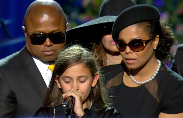 Paris Jackson, then 11, tearfully expressed her love for her father, Michael Jackson, at his memorial service in 2009 as uncle Randy and aunt Janet supported her.