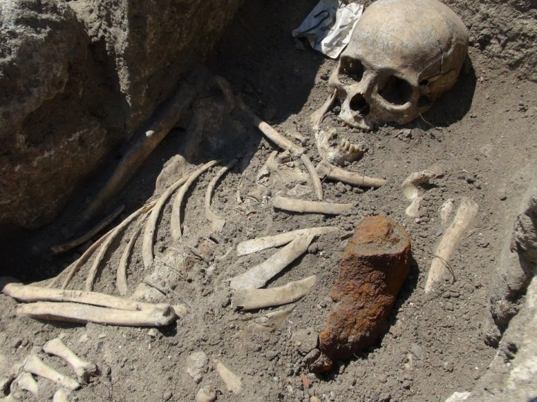 A piece of iron lies next to a skeleton dating back to the Middle Ages at an archaeological dig in the Black Sea town of Sozopol. Bulgarian archaeologists say they have found skeletons that were pinned down through their chests with iron rods - a practice believed to stop the dead from rising as vampires.