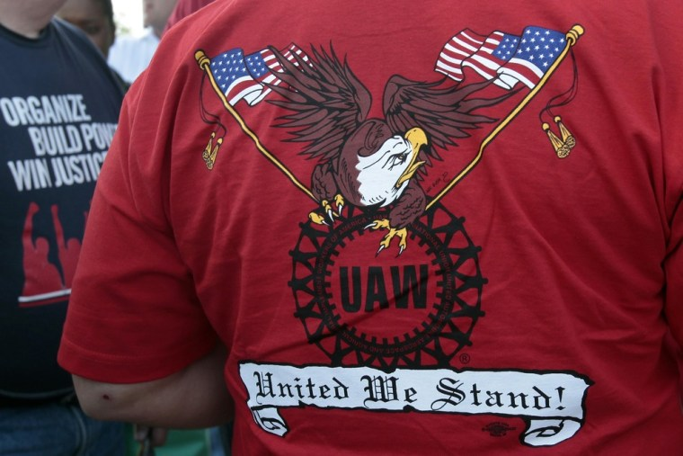A United Auto Workers member wears a shirt proclaiming