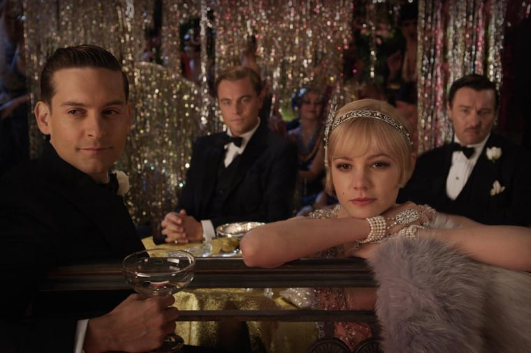 Posing pretty: Tobey Maguire, Leonardo DiCaprio and Carey Mulligan star in the upcoming adaptation of The Great Gatsby, which has already started to infiltrate fashion.