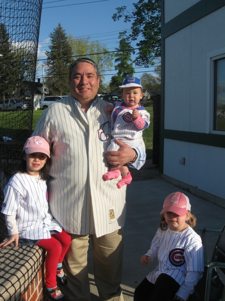 Dad and his three girls -- Cecilia, Olivia, Sofia, enjoy  Daddy time at a baseball game.