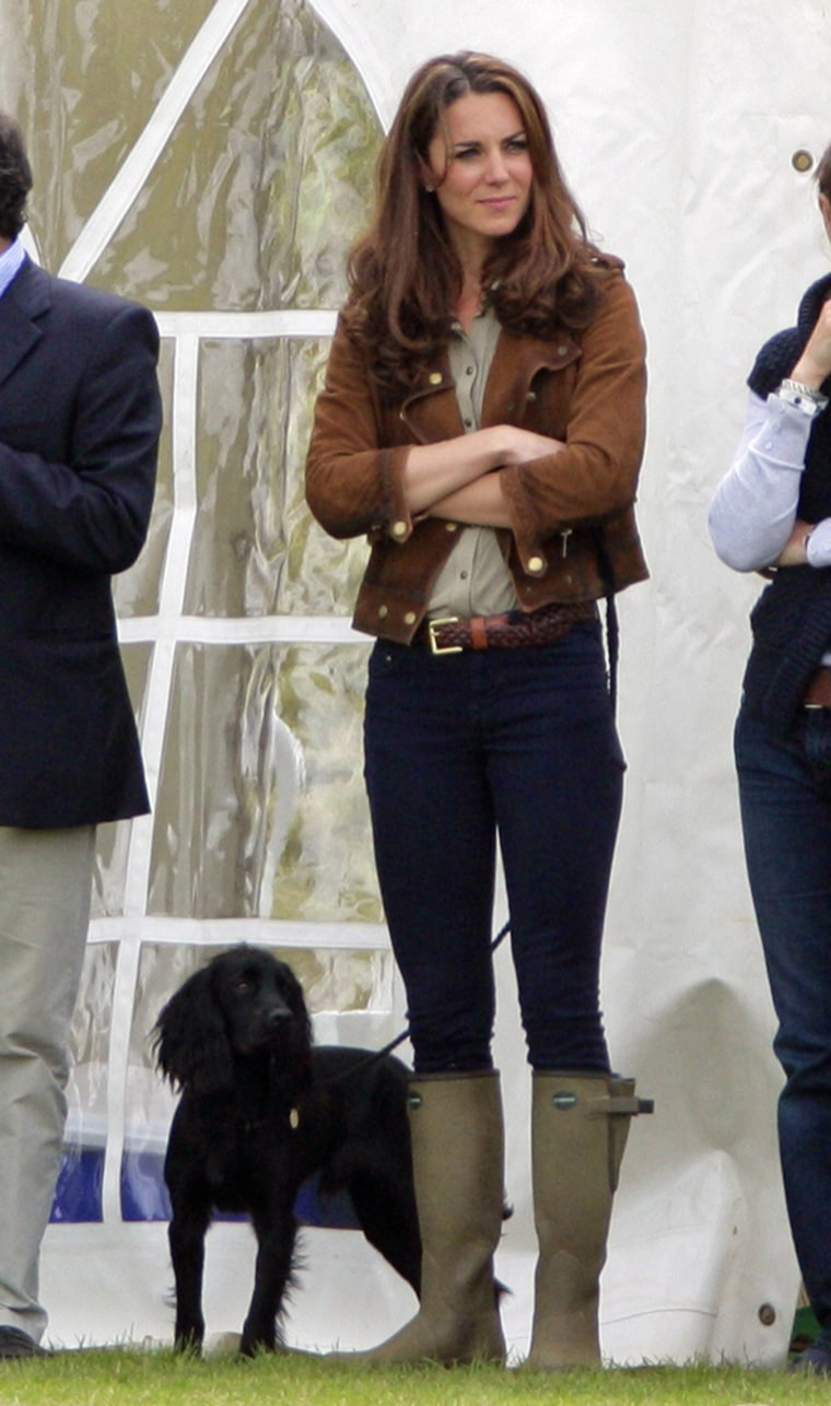 Puppy love: Kate, with her pup, Lupo, attends The Golden Metropolitan Polo Club Charity Cup polo match, in which Prince William and Prince Harry played, at the Beaufort Polo Club on June 17.