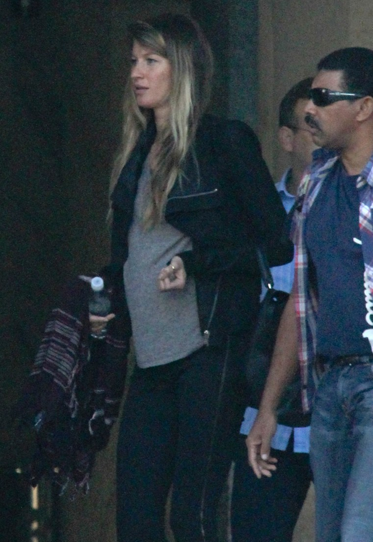 Gisele Bundchen shows her baby bump while in Rio.