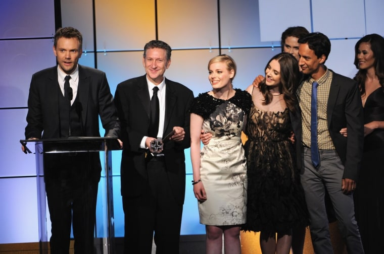 """Actors Joel McHale, producer Russ Krasnoff, Gillian Jacobs, Alison Brie and Danny Pudi of """"Community"""" accept the award for Best Comedy Series from presenter Emily Deschanel onstage during The Broadcast Television Journalists Association Second Annual Critics' Choice Awards in Beverly Hills on Monday."""