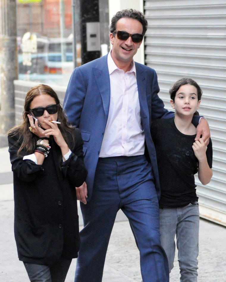 Mary-Kate Olsen, left, with Olivier Sarkozy and his daughter in New York on June 14.