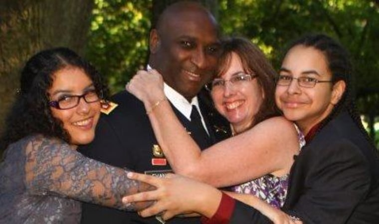 Adrae Evans with his daughter Ariel, wife Kristin, and son Gabe, before his 4th deployment.