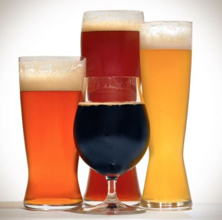 Jim Galligan tests out beer glasses tailored specifically for different types of brews.