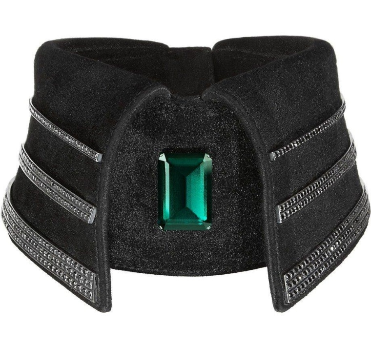 Karl Lagerfeld is selling one expensive accessory: a $37,500 black diamond and emerald collar. Part of the proceeds will benefit a charity for children with cancer.