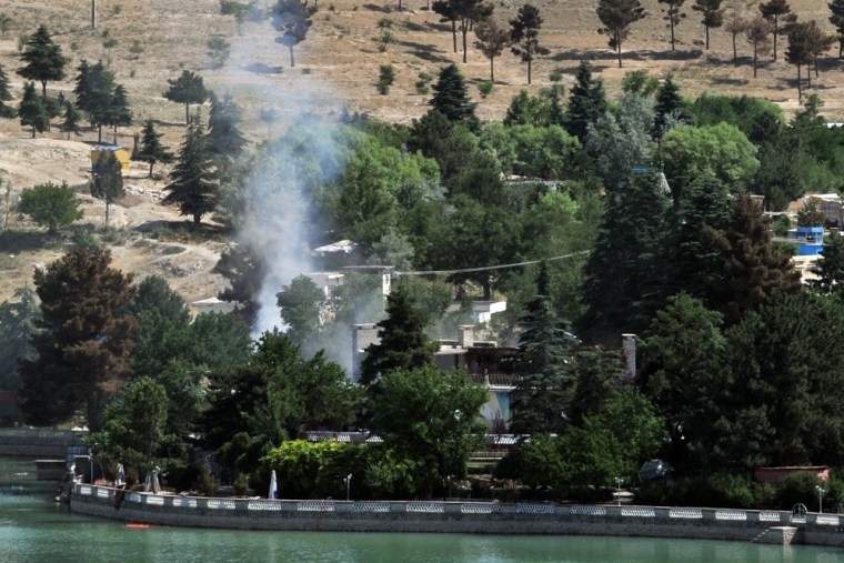 Smoke rises from the Spozhmai Hotel following an attack by Taliban militants on June 22, 2012.