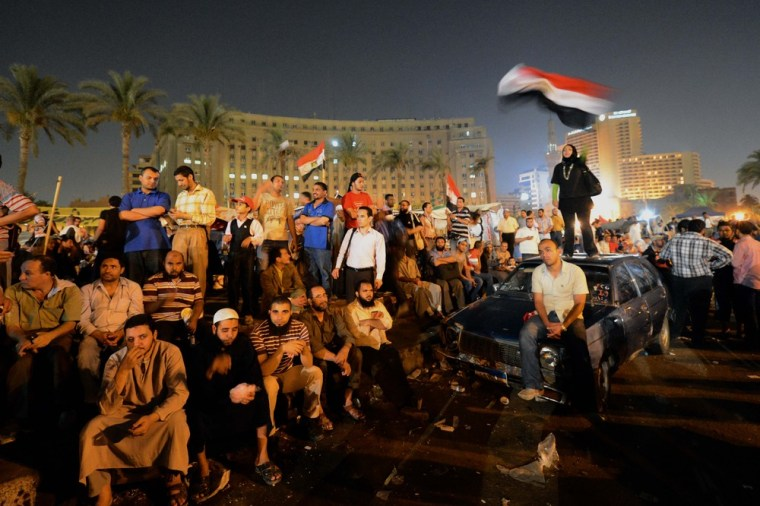 Supporters of the Muslim Brotherhood presidential candidate Mohamed Morsi attend a rally in Cairo's Tahrir Square on June 21, 2012.