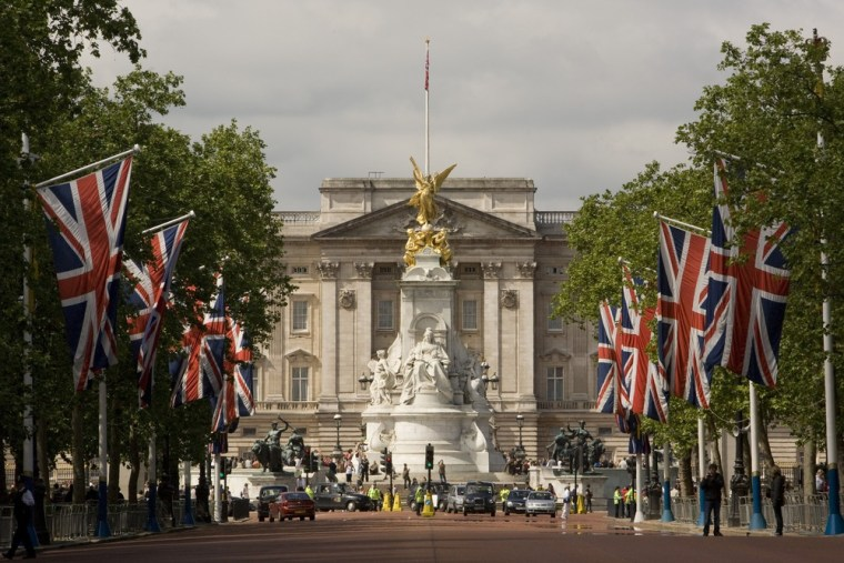 A view looking down The Mall toward Buckingham Palace and Victoria Memorial in London.