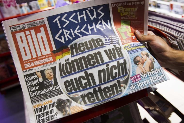 A man takes a copy of the German