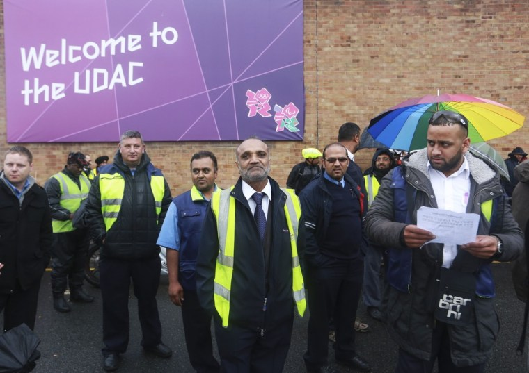 Bus drivers stand on a picket line near the West Ham Bus Garage in east London on Friday.