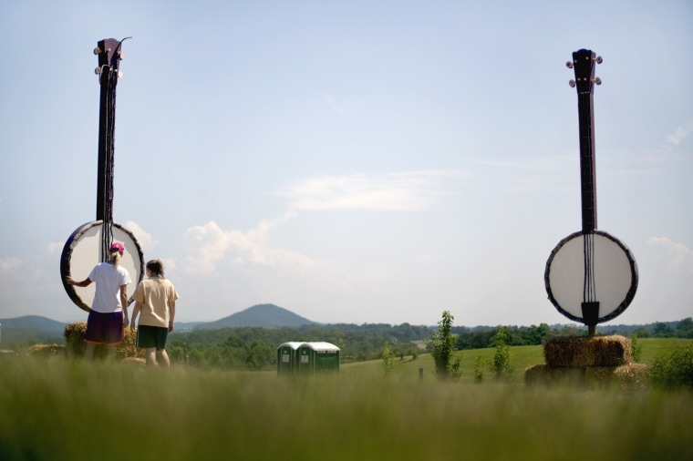 """Land art representing """"Dueling Banjos,"""" a reference to the movie """"Deliverance"""", stands at the entrance to the Chattooga River Festival in Long Creek, S.C. on June 22, 2012. Communities along the Chattooga River are celebrating the 40th anniversary of the movie's release with the first-ever Chattooga River Festival. Some locals are unhappy with reminding the world to the area's connection to the movie. Festival organizers say they hope the event can be an annual draw that raises money to preserve the Chattooga River and promotes environmental stewardship."""