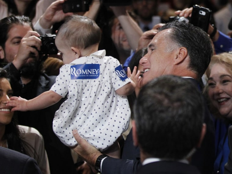 Mitt Romney greets attendees at the National Association of Latino Elected and Appointed Officials conference in Orlando, Fla.