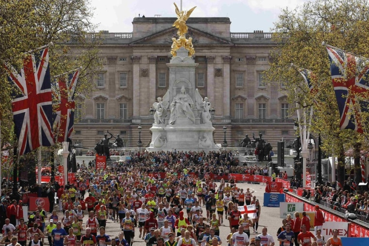 Runners approach the finish line at Buckingham Palace in the London Marathon on April 22, 2012.