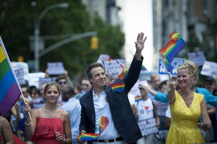 New York State Gov. Andrew Cuomo (L) and his girlfriend Sandra Lee march in the gay pride parade in New York, June 24, 2012.