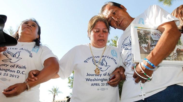 Members of Promise Arizona, from left, Leonila Martinez, Patricia Rosas and Gustavo Cruz, react to the U.S. Supreme Court decision on Arizona's controversial immigration law in Phoenix on Monday.
