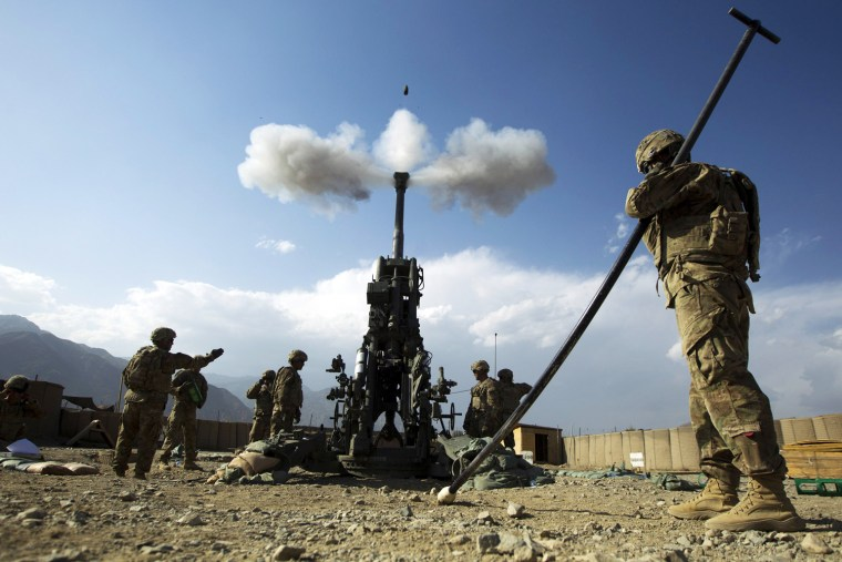 Soldiers from Alpha Battery 2nd Platoon Field Artillery fire a 155mm Howitzer towards insurgent positions at forward operating base Joyce in Afghanistan's Kunar Province on June 25, 2012.