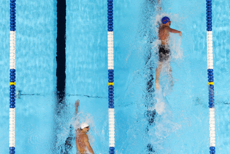 Ryan Lochte, right, leads Michael Phelps in the men's 400-meter individual medley final at the U.S. Olympic swimming trials, Monday, June 25, 2012, in Omaha, Neb.