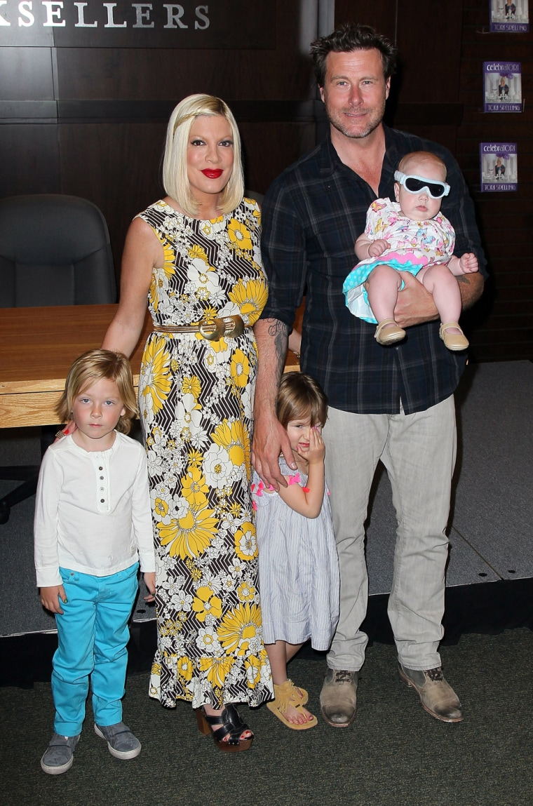 Tori Spelling and husband actor Dean McDermott pose with their children (L-R) Liam, Stella and Hattie.