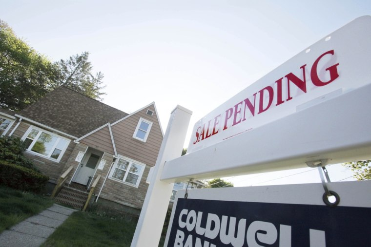 In this April 26, 2012, file photo, a sign advertises a pending residential real estate sale in Framingham, Mass.
