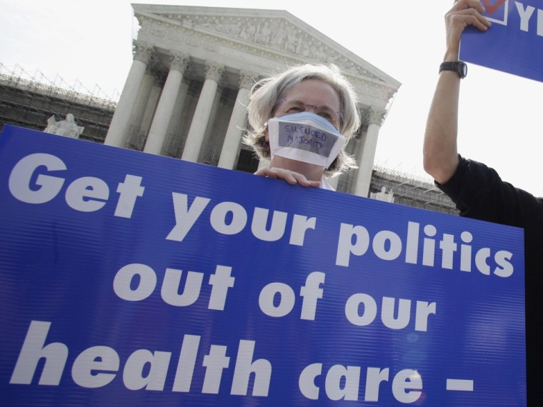 A group of doctors protest against individual mandate in President Obama's health care reform in front of U.S. Supreme Court in Washington June 25.