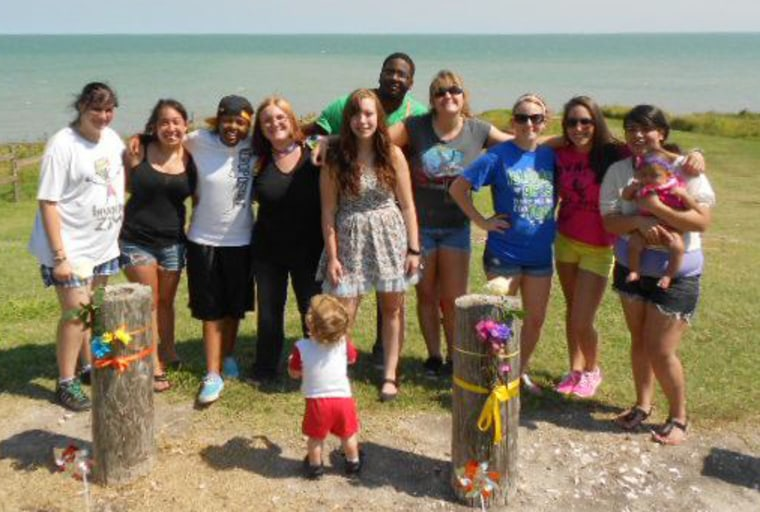 Charlene Camp, Hilary Avila, Myracle Taylor, Bailey Sanders, Jillian Manuel, Tim Robinson (behind Manuel), Kristen Veit, LuAnn Garza, Valerie Tanon and Franceska Hiracheta were some of the couple's friends and well-wishers who created a memorial at the site around where police believe the young women were attacked last week in Portland, Tex.