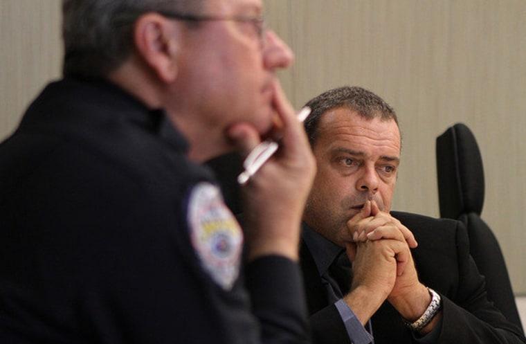Sanford, FL police investigator Chris Serino, at right.