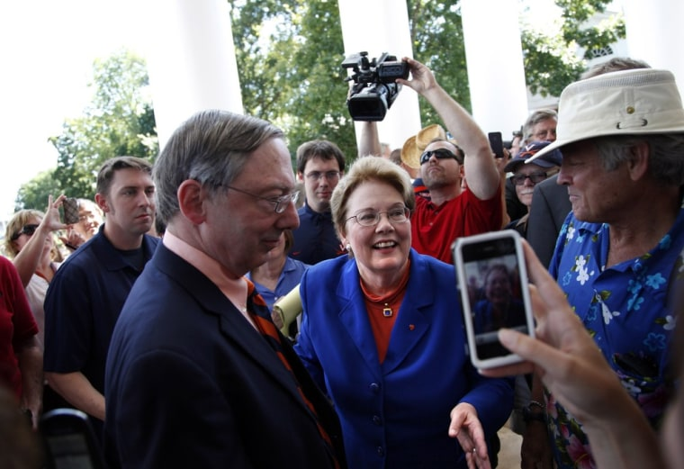 University of Virginia President Teresa Sullivan weaves through supporters and media after she was reinstated on Tuesday.