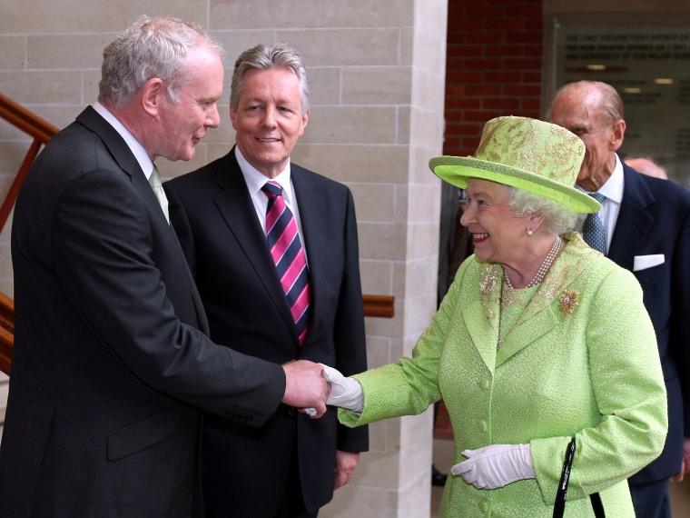 Britain's Queen Elizabeth II shakes hands with Northern Ireland Deputy First Minister Martin McGuinness in Belfast on Wednesday.
