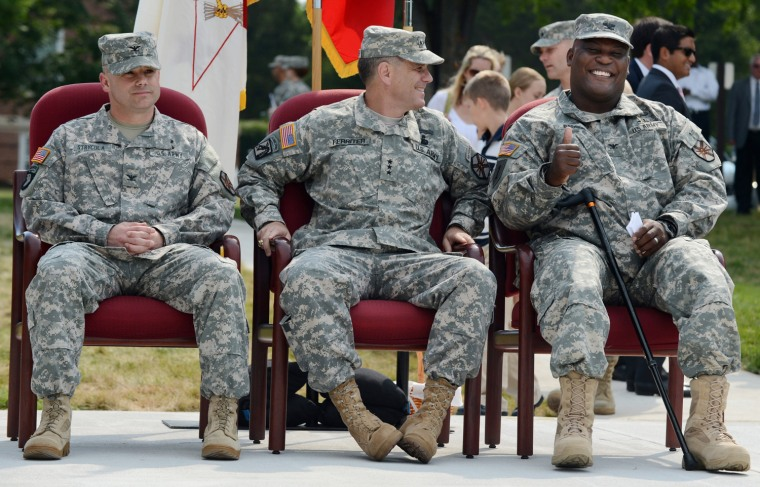 Col. Gregory Gadson, right, attends a ceremony where he assumes command of U.S. Army Fort Belvoir. He is sitting next to outgoing commander Col. John Strycula, left, and Lt. Gen. Michael Ferriter, center, at Fort Belvoir, Virginia, outside Washington, D.C. on Monday.