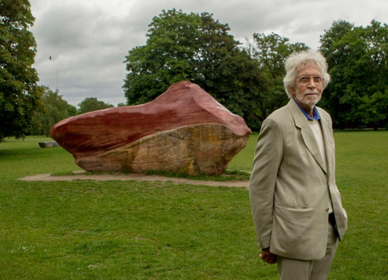 German artist Wolfgang von Schwarzenfeld stands in front of a stone from Venezuela that is part of the Global Stone installation in the Tiergarten park in Berlin, Tuesday.