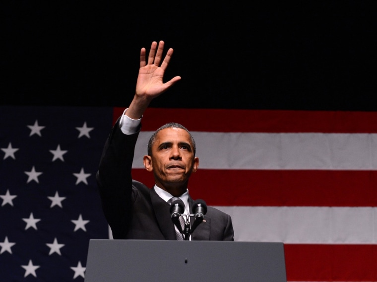 President Barack Obama waves at supporters after speaking at Obama Victory Fund concert in Miami, Fla.