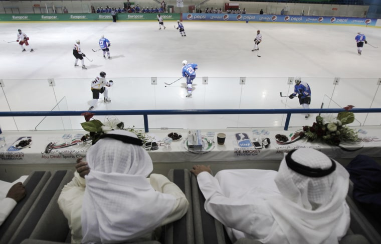 Emirati and Kuwaiti officials watch a hockey match between Oman and Kuwait in Abu Dhabi, United Arab Emirates on May 31, 2012.