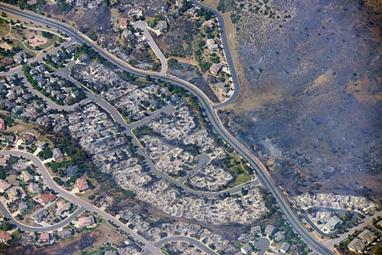 An aerial photo taken Wednesday of burned homes in a residential area of Colorado Springs.