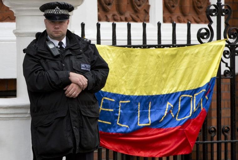 A police officer stands guard outside Ecuador's Embassy in London where WikiLeaks founder Julian Assange has taken refuge on June 22.