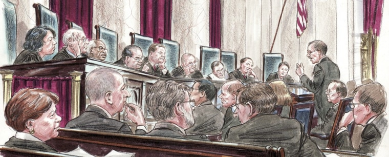 In this courtroom illustration, U.S. Solicitor General Donald Verrilli (R) speaks at the lectern to members of the U.S. Supreme Court in Washington March 27, 2012.