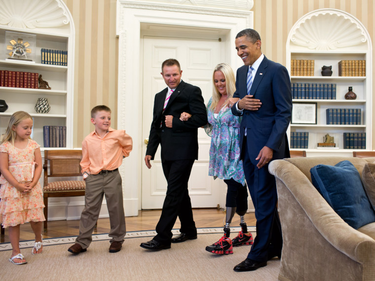Walking tall: President Barack Obama welcomes Stephanie Decker, her husband Joe Decker, and children Reese and Dominic, to the Oval Office, June 29, 2012.