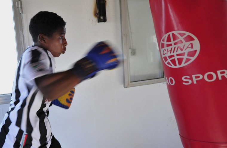 Issa Mahmoud, 14, practises with a punching bag during a boxing training session in Libya on June 27, 2012. Boxing, which was banned in 1979 by former Libyan leader Muammar Gaddafi, has made a comeback with five boxing clubs to train at in Tripoli.